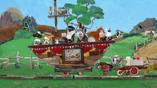 Alle steigen auf die alte Seekuh und können damit dank Jettes Bahn über die Insel fahren. | Rechte: KiKA/Sixteen South