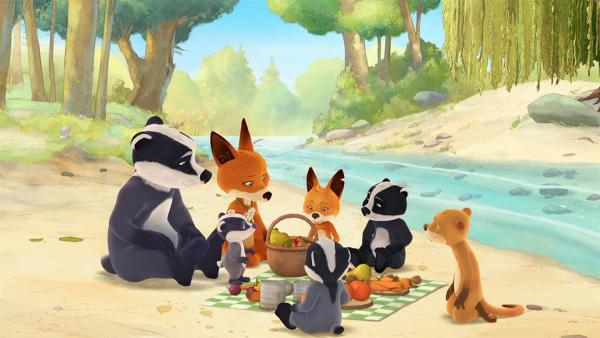 Die Familie macht ein Picknick am Bach. | Rechte: WDR/Mediatoon