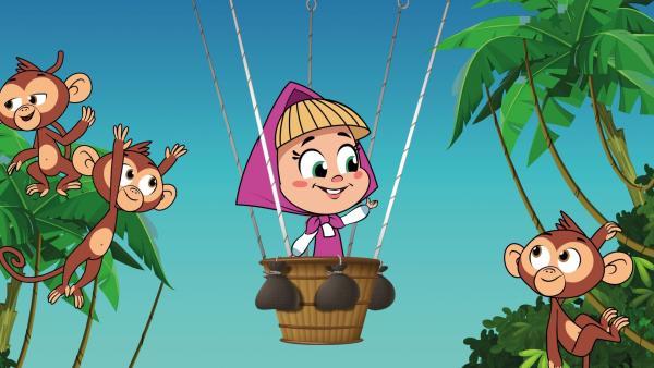 Mascha fliegt in einem Heißluftballon an Affen vorbei. | Rechte: KiKA/Animaccord LTD 2008