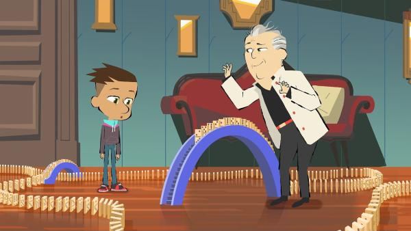 Der Maestro legt mit Geduld Dominosteine und Max sieht ihm dabei zu. | Rechte: hr/Monello Productions - MP1