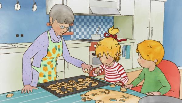 Conni und Jakob wollen Mama mit selbstgebackenen Plätzchen überraschen. Probieren ist natürlich erlaubt! | Rechte: ZDF/Henning Windelband/Youngfilms GmbH