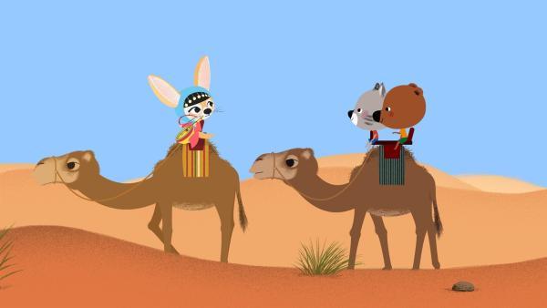 Mouk und Chavapa sind in Afrika, in der Sahara. Zusammen mit ihrer Freundin Aischa wollen sie zu einem Musikfestival mitten in der Wüste. | Rechte: KiKA/Millimages