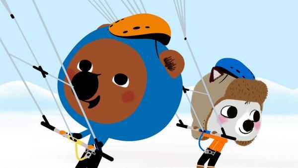 In Kanada gehen Mouk und Chavapa mit ihrem Freund Amaruk Snowkiten. | Rechte: KiKA/Millimages