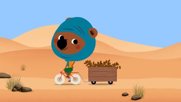 Mouk mit seinem Fahrrad in der Sahara | Rechte: KiKA/Millimages