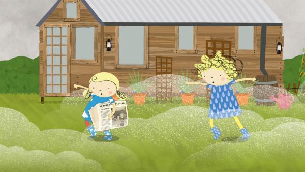 Während Nora und Nele in der Feuchte stapfen, wird die Zeitung auch ganz nass. | Rechte: KiKA/Geronimo Productions
