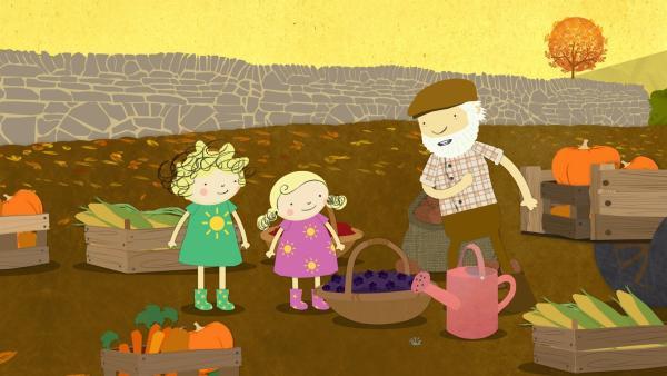 Zufrieden zeigt Bauer Jost seine leckere Ernte Nele und Nora. | Rechte: KiKA/Geronimo Productions