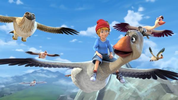Nachdem Nils Akka gerettet hat, darf er auf ihrem Rücken fliegen und die Schar anführen. | Rechte: BR/Studio 100 Animation/Studio 100 NV