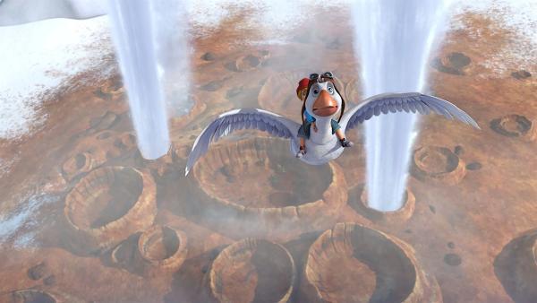Zwischen den kochend heißen Geysiren zu fliegen, ist eine wahre Herausforderung für Martin. | Rechte: BR/Studio 100 Animation/Studio 100 NV