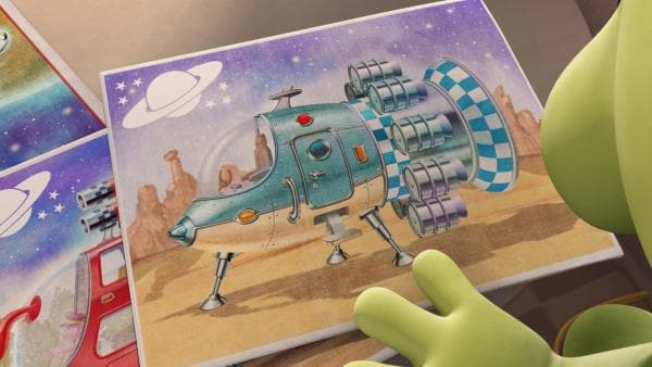 Pootle beschließt, sich ein neues Raumschiff zu besorgen. Ohne sich entscheiden zu können, sucht er in Groobies Katalog nach einem passenden Modell.   Rechte: KiKA/Snapper Productions/Q Pootle 5 LTD