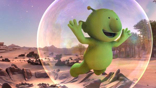 Pootle schwebt in einer großen Blubberblase durch die Luft. Er ist ganz begeistert. | Rechte: KiKA/Snapper Productions/Q Pootle 5 LTD