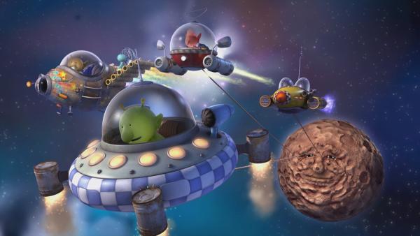 Fred (r.) wäre gern beim Konzert dabei, doch als Planet kann er sich nicht bewegen. Pootle und seine Freunde schaffen es auch nicht, ihn mit ihren Raumschiffen vom Fleck zu ziehen. | Rechte: KiKA/Snapper Productions/Q Pootle 5 LTD