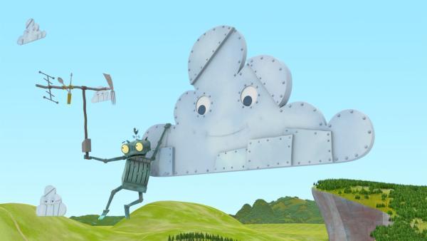 Ritter Rost versucht, den Fernsehempfang zu verbessern, indem er sich an eine von Schrottlands Wolken hängt. | Rechte: ZDF/Caligari