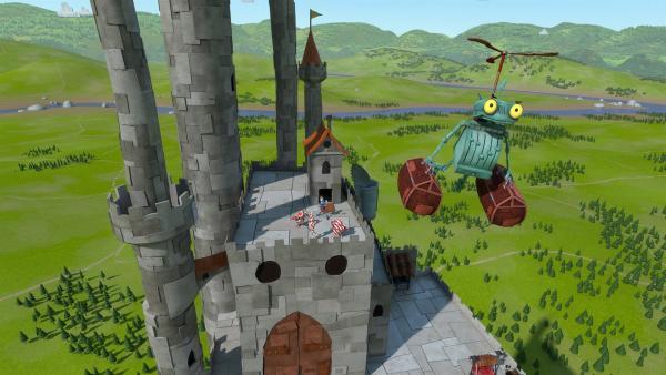 Ritter Rost muss aus seiner eigenen Burg fliehen. Er benutzt dabei einen Ein-Personen-Helikopter-Rucksack. Diese Erfindung hat Rösti nach Plänen seines verstorbenen Vaters zusammengebaut. | Rechte: ZDF/Caligari Film- und Fernsehproduktion