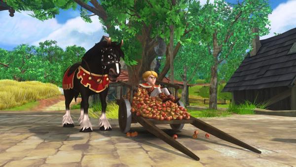 Das ist wohl nicht so ausgegangen, wie geplant: Prinz John ist unsanft auf einem mit Äpfeln beladenen Karren gelandet. | Rechte: ZDF/Method Animation/DQ Entertainment/Fabrique d'images/ZDF Enterprises/De Agostini