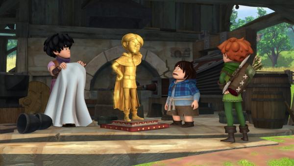 Prinz John hat sich eine goldene Statue gießen lassen. Das Gold dazu nahm er den Bürgern in Form von neuen Steuern weg. Little John, Tuck und Robin Hood haben einen Plan. | Rechte: ZDF/Method Animation/DQ Entertainment/Fabrique d'images/ZDF Enterprises/De Agostini