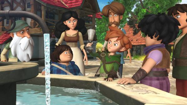 Robin testet, ob das Wasser im Dorfbrunnen wieder genießbar ist. Seine Gefährten und die Dorfbewohner sind gespannt. | Rechte: ZDF/Method Animation/DQ Entertainment/Fabrique d'images/ZDF Enterprises/De Agostini