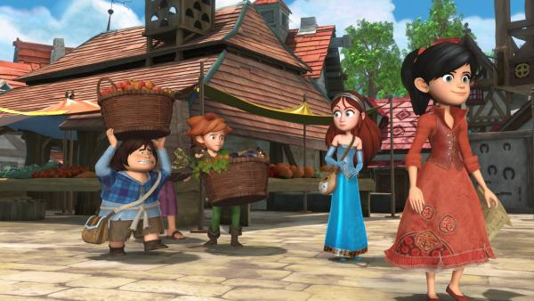 Scarlett und Marian machen einen Einkaufsbummel im Dorf. Tuck und Robin Hood haben schwer zu tragen. | Rechte: ZDF/Method Animation/DQ Entertainment/Fabrique d'images/ZDF Enterprises/De Agostini