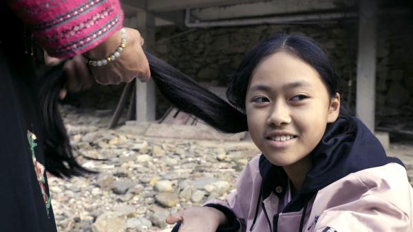 Panyuan und ihre langen Haare. | Rechte: SWR/Thomas Bresinsky