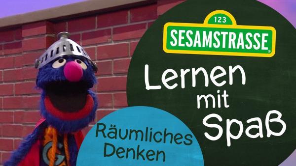 "Grobi mit dem Logo ""Lernen mit Spaß"" | Rechte: NDR/Sesamstraße Foto: Grafik"