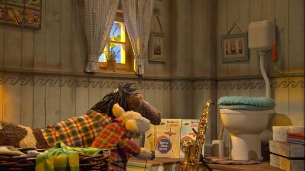 Günni möchte einmal das Bad verlassen und auf ein Konzert seiner Lieblingsband gehen. | Rechte: NDR/Sesame Workshop