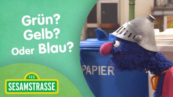 Links steht ein Puppen Mädchen vor einer gelben Mülltonne rechts Super-Grobi mit Helm und Supermann Umhang.In der Mitte steht die Schrift Super-Grobi | Rechte: NDR