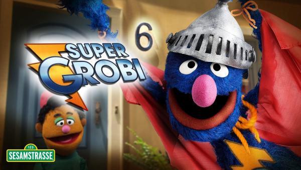 Links der Show Moderator Guy Smiley rechts der blaue Super-Grobi mit Helm und Supermann-Umhang | Rechte: NDR