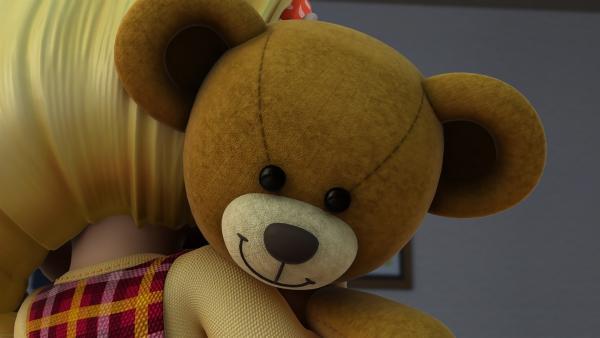 Endlich kann Cecily ihren Teddy in den Arm nehmen – und er spricht sogar.    Rechte: KiKA/FunnyFlux/QianQi/EBS/CJ E&M