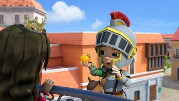 Ritter Carlos überreicht Prinzessin Isabel eine Orange.   Rechte: KiKA/FunnyFlux/QianQi/EBS/CJ E&M