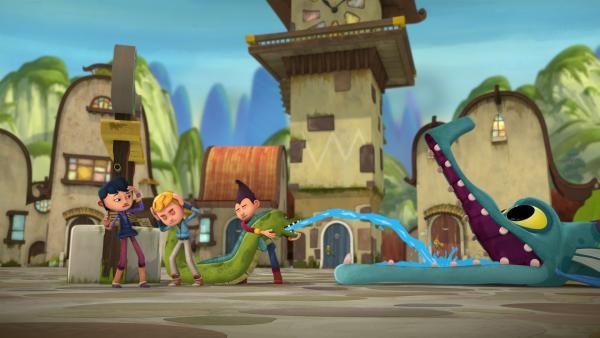 Lotus, Jack und Tashi versuchen den Mund des Feuerdrachen zu kühlen.  | Rechte: KiKA/Flying Bark Productions Pty Ltd.