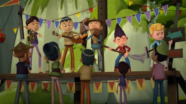 Tashi und Jack amüsieren sich mit der Musikergruppe.  | Rechte: KiKA/Flying Bark Productions Pty Ltd.