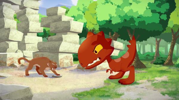 Als ein Tiger Tib angreift, stellt sich der Dinosaurier dazwischen und rettet Tib erneut.   Rechte: KiKA/hr/TF1/GO-N Productions