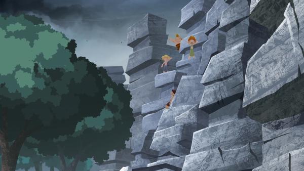 Entgegen Arons Ansage, befinden sich alle Kinder an den Felsen im Wald, als der Tornado durchs Tal fegt.     Rechte: KiKA/hr/TF1/GO-N Productions