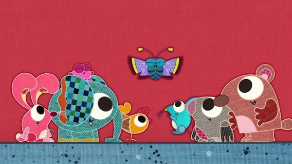 Auf meiner Schmusedecke ist richtig was los!  Hier wohnen viele Tiere zusammen, doch es gibt immer  ein Problem: hier ist das Huhn, sein Ei steckt fest! Da ist der Fisch ganz ohne Wasser - und der Fuchs  will immer alle mit Haut und Haaren fressen! | Rechte: rbb/Studio FILM BILDER