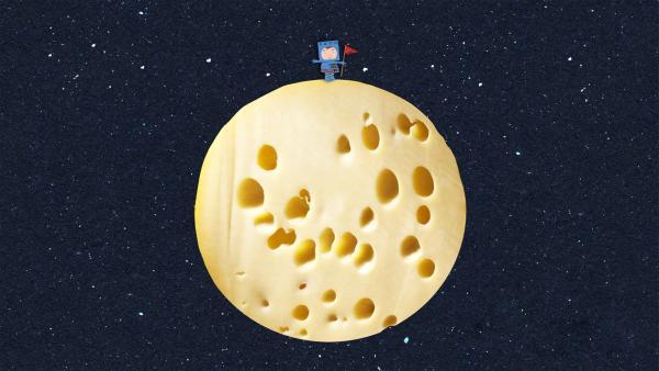 Timmi steht mit einer Flagge auf dem Mond. | Rechte: MDR/rbb/NDR/MotionWorks