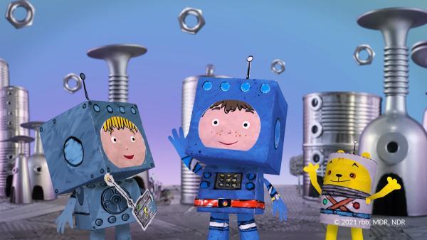 Timmi und Teddy lernen einen Bewohner des Roboterplaneten kennen. | Rechte: rbb/MDR/NDR/MotionWorks
