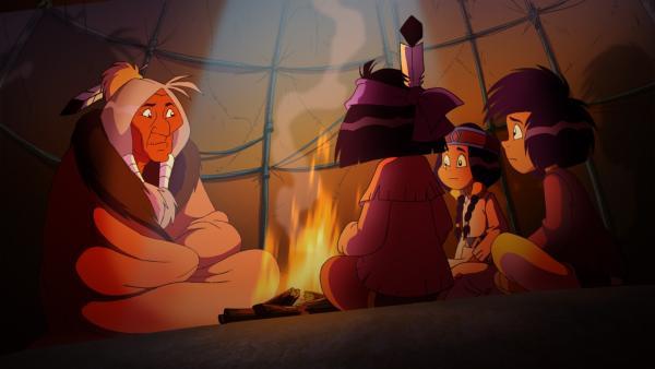 Yakari und seine Freunde lauschen den Erzählungen von Stiller Fels über den Sasquatch. | Rechte: WDR/Storimages