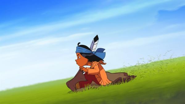 Yakari schnellt mit einem Bisonfell einen Abhang hinab. | Rechte: WDR/Ellipsanime Productions/Belvision/Les Cartooneurs Associés/2 Minute