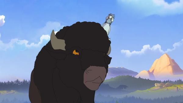 Rabe Krickrack mit weißem Federkleid zusammen mit einem Bison | Rechte: WDR/Ellipsanime Productions/Belvision/Les Cartooneurs Associés/2 Minute