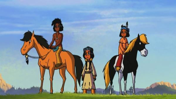 Yakari, Kleiner Dachs und Regenbogen sind mit ihren Ponys unterwegs, als plötzlich zwei Irokesen auftauchen und behaupten, Großer Grauer, das Pony von Regenbogen, gehöre ihnen.  | Rechte: Storimage
