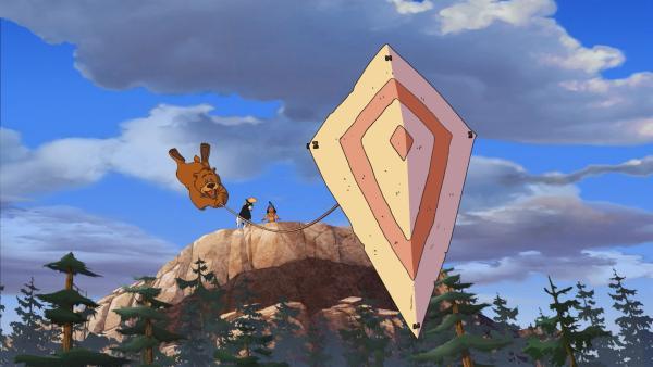 Bär Honigtau wird von dem Flugdrachen, den Yakari gebaut hat, weggeweht. | Rechte: WDR/Storimage