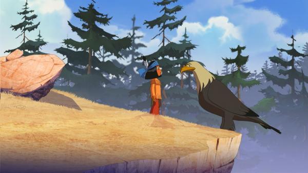 Yakari befragt einen Adler nach Regenbogen. | Rechte: WDR/Storimage