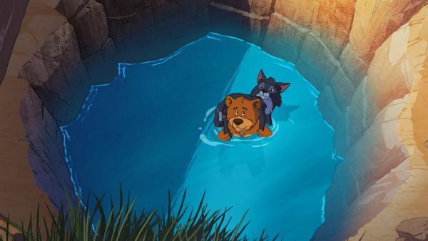 Haben sich vor einem Vielfraß in ein Loch gerettet: Bär Honigtau und Wolf Kleiner Hauer. | Rechte: WDR/Storimage