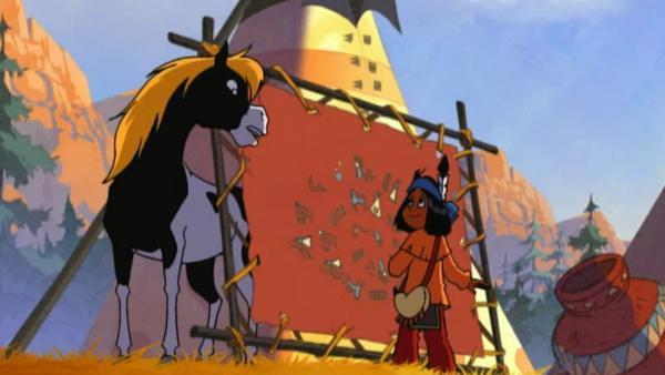 Yakari und Regenbogen entdecken beim Medizinmann eine alte bemalte Bisonhaut, die die Geschichte ihres Stammes schildert. | Rechte: WDR/Storimages