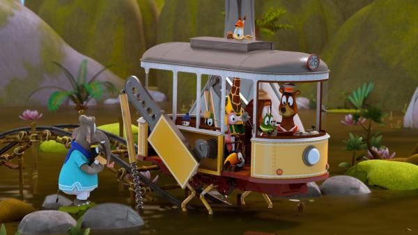 Zacki (Krokodil) hat die Grashüpferbeine der Zoobahn ausgefahren. Damit wollen sie durch den Sumpf springen.   Rechte: ZDF/Grid Animation