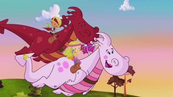 Zoé und Finn machen als Prinzessin und Ritter beim Fang-die-Flagge-Turnier mit. Bevor sie auf ihren fliegenden Drachen loslegen können, helfen sie Finns rotem Drachen, Früchte von Gemüse zu unterscheiden. | Rechte: KiKA/Mike Young Productions