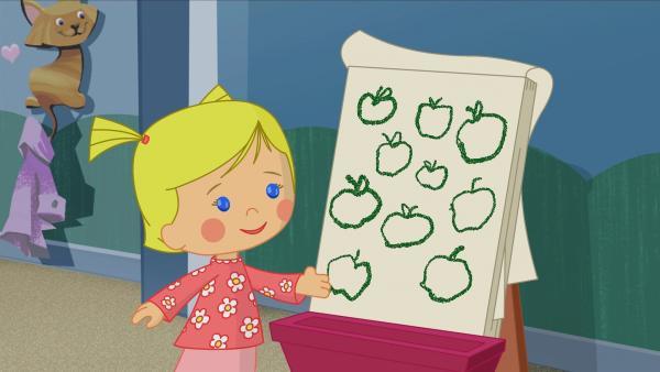 Zoé spielt mit ihren Freunden Schule. Sie sollen heute die Äpfel auf ihrer Tafel zählen. | Rechte: KiKA/Mike Young Productions