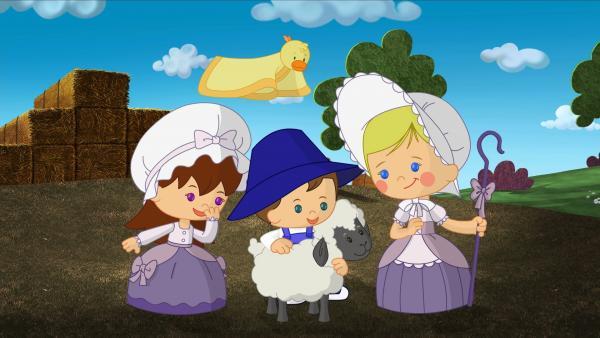 Lili, Max und Zoé hüten kleine Schafe.   Rechte: KiKA/Mike Young Productions